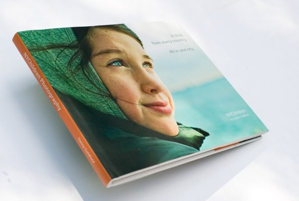 NYChildren Photography Book by Danny Goldfield. Features a 12 year old girl's face on the cover as shee looks into the distance, the future.