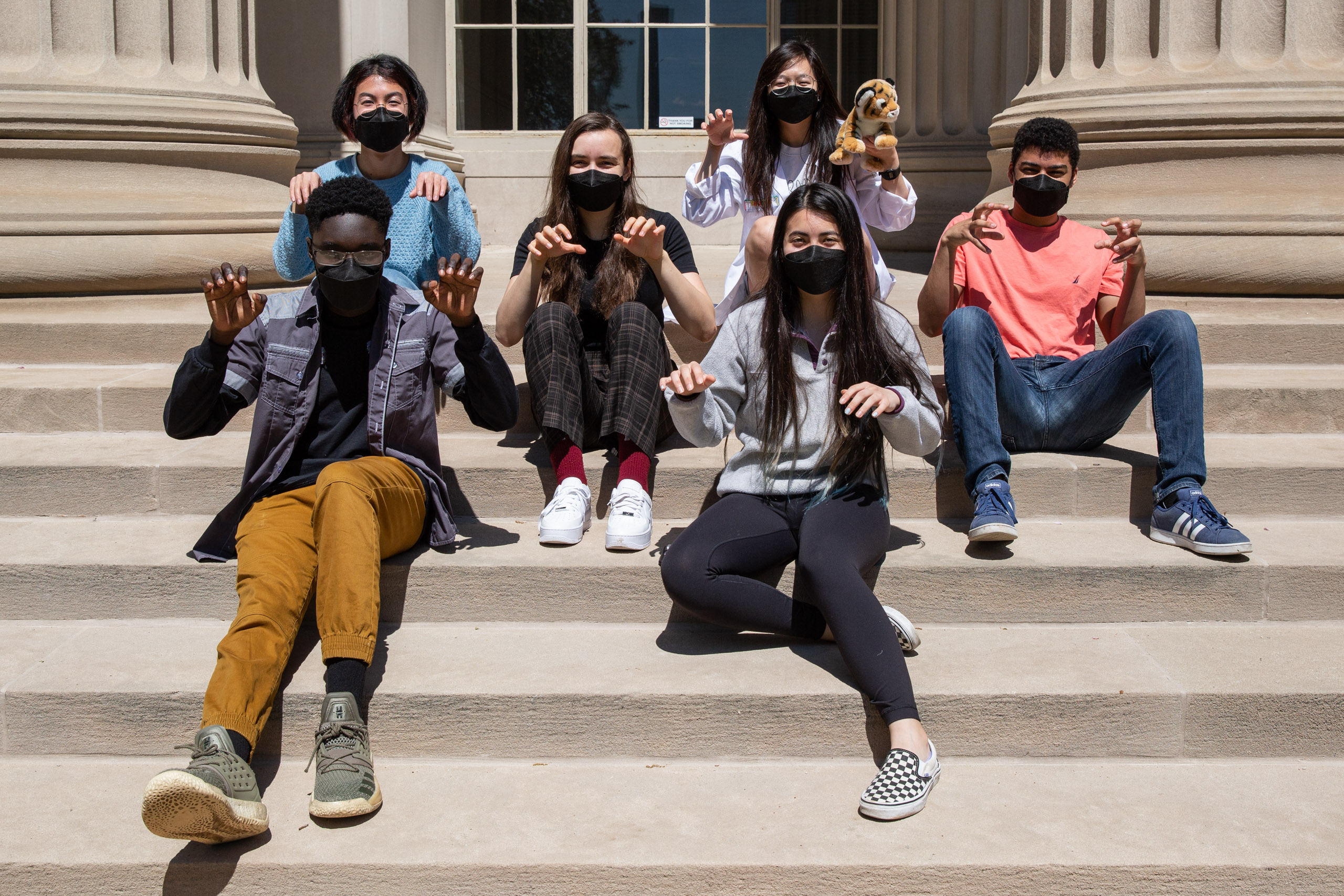 MIT student in Toy design class 2.00b Spring 2021 remove their masks. Series by Photographer Danny Goldfield.
